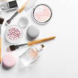 Makeup,Products,With,Cosmetic,Bag,And,Macaroons,On,Light,Background